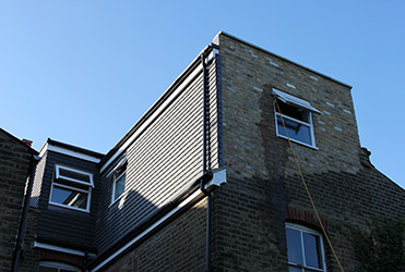 Shaped dormer loft conversion exterior view