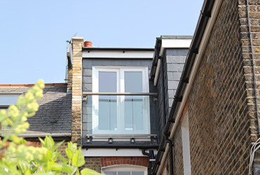 Mansard dormer loft conversion with juliette balcony