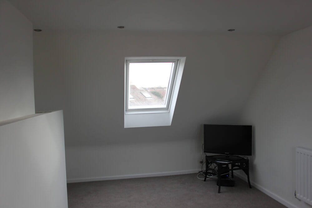Complex low ridge conversion in house in Watford
