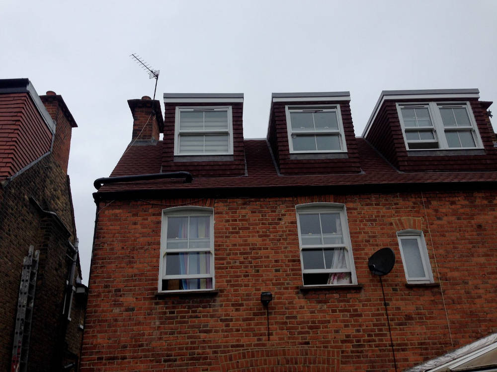 Three flat roof dormers in a house in Balham