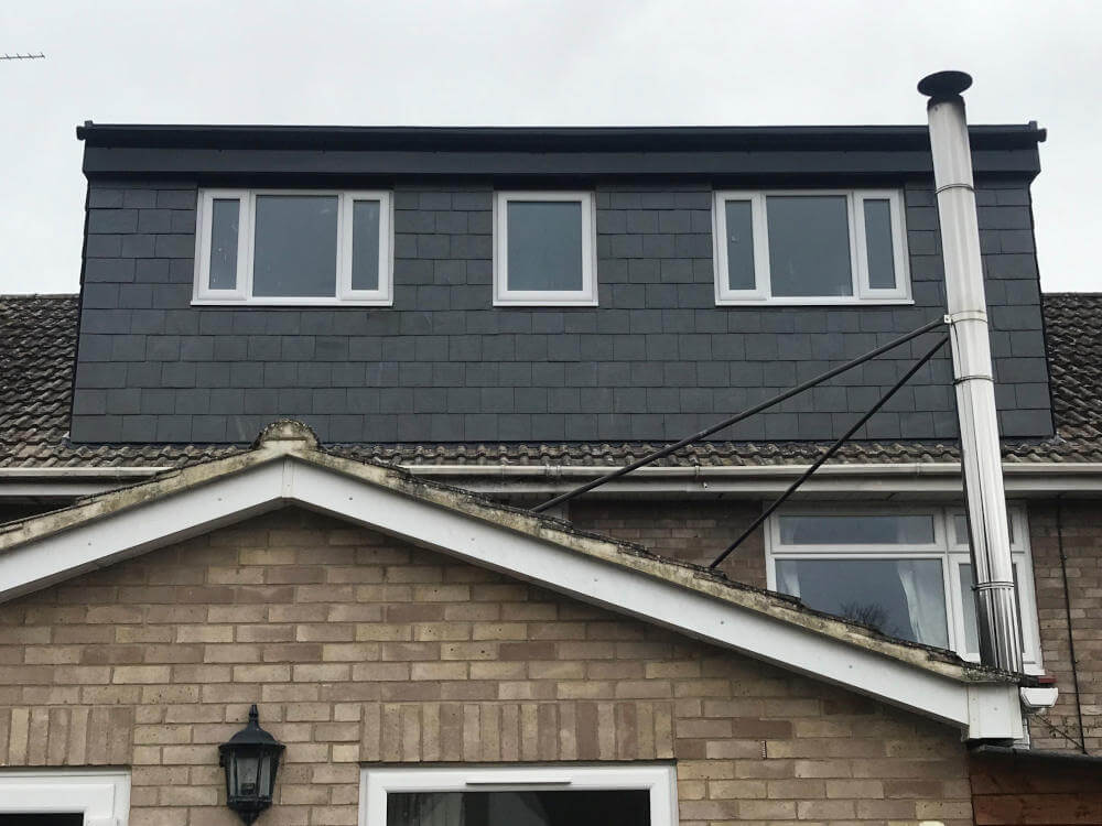 Touchstone lofts slate flat roof dormer loft conversion in a house in raynes park sw20