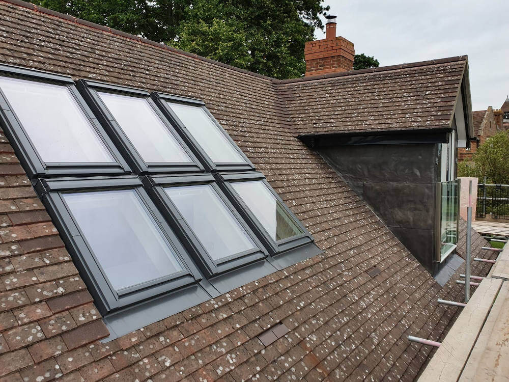 Touchstone lofts velux window leaded pitch roof dormer loft conversion in a house in Croydon